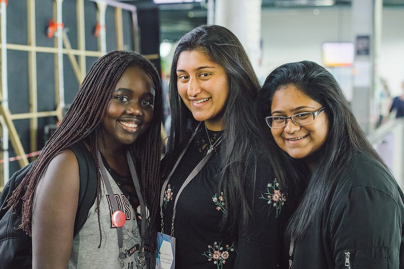 A photograph of three participants standing together and smiling at MozFest 2017