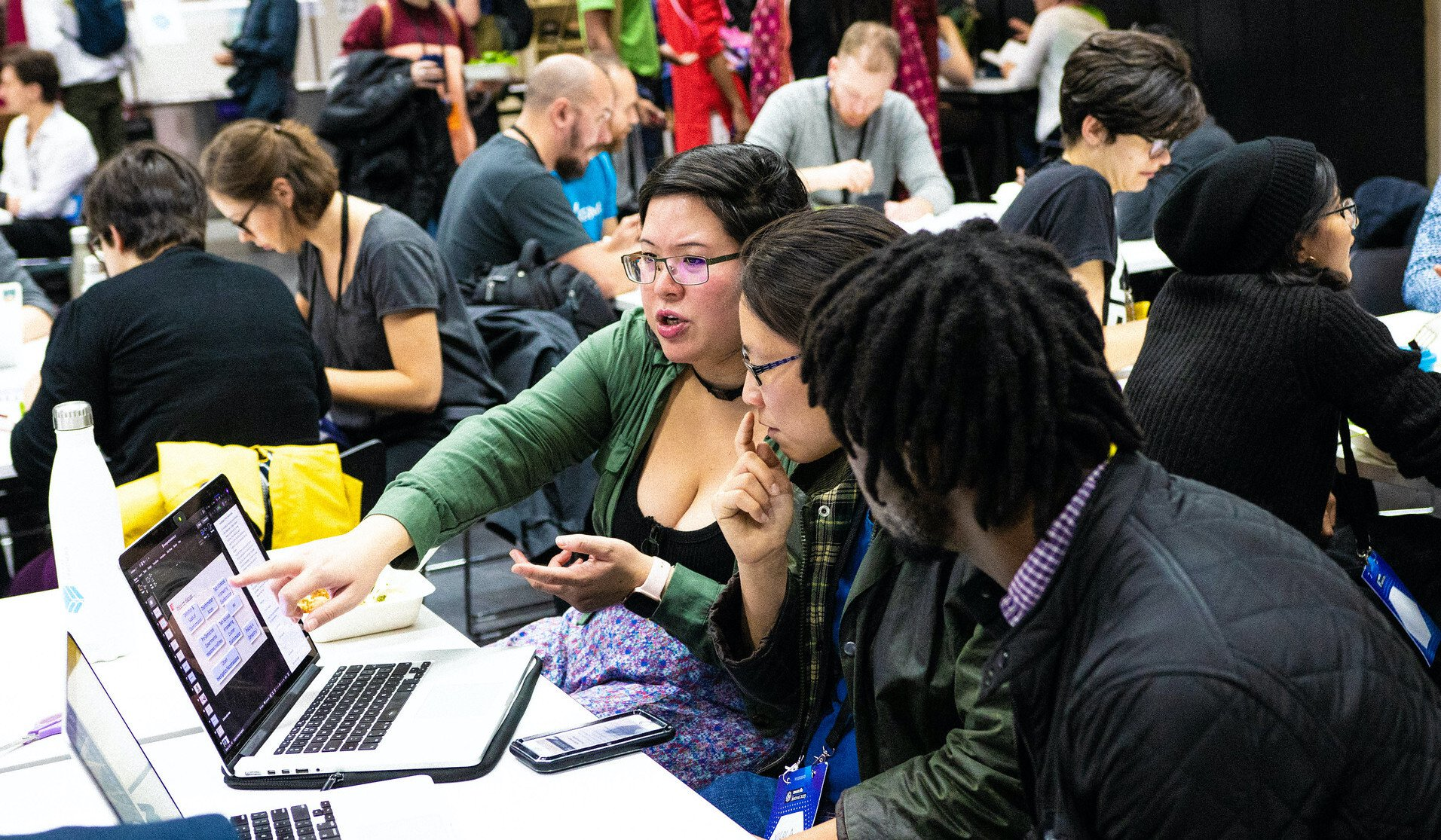A group of participants taking part in a session at MozFest