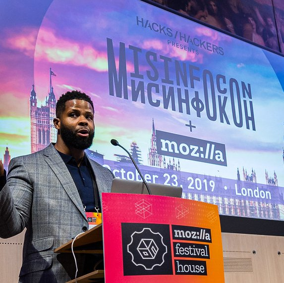 A speaker on stage at MisInfoCon, an event held as part of MisInfoCon held at MozFest House