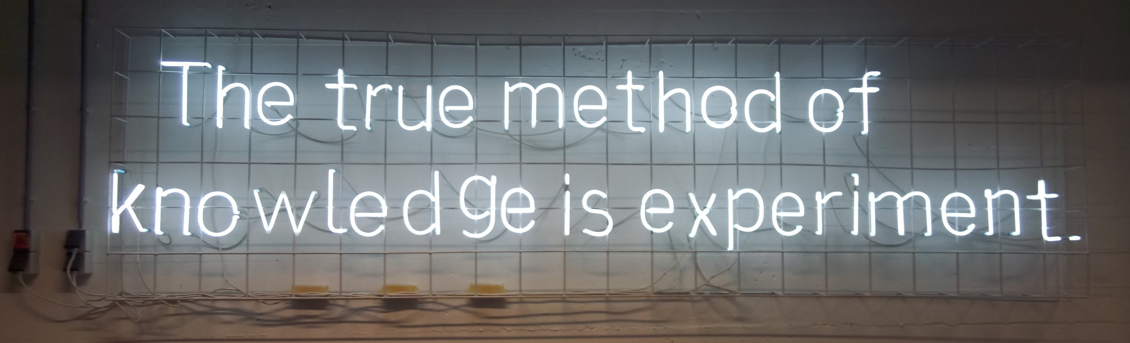 """Image of the  words """"The true method of Knowledge is experiment"""" in Neon lights,taken in Baltan Labs, Eindhoven."""