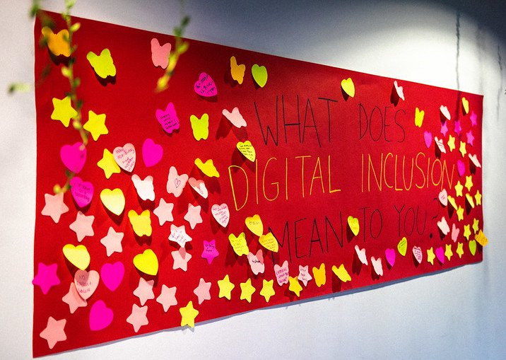 Photo by Connor Ballard-Pateman of giant poster asking What does Digital Inclusion mean to you?