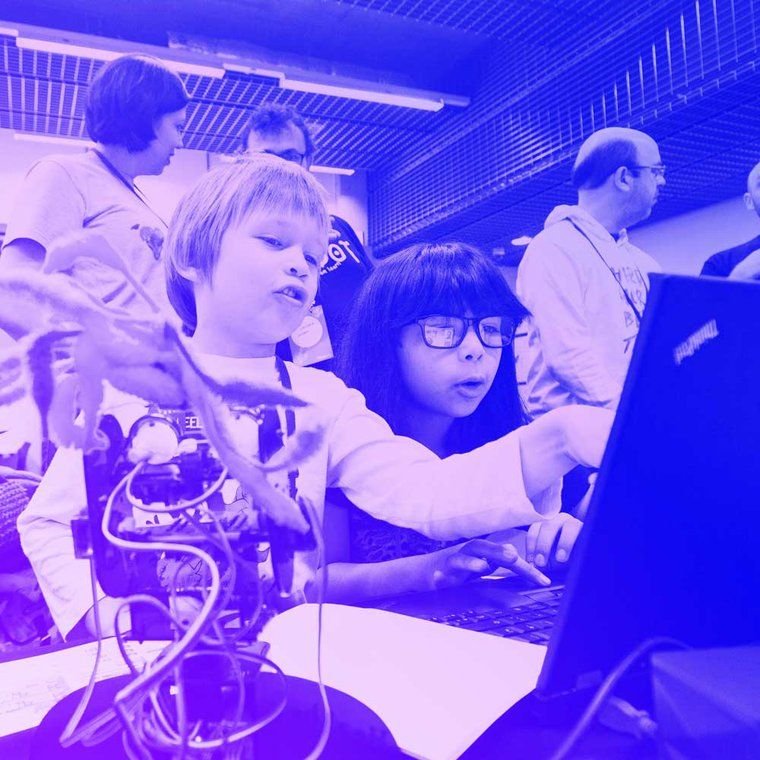 Two young participants, working together on a laptop at MozFest